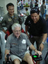 TFC General Manager Worawoot helping Papa Dave land the Bearcat at Hua Hin on the simulator at Sarex 2008