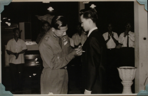 Khun Thira receiving his wings.
